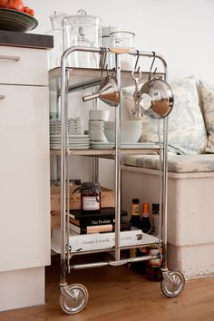 Neat Idea: Use a Bar Cart To Store Pretty Dishes & Kitchen Odds and Ends Kitchen Inspiration