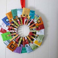 tea bag wreath; I actually make one with a hanger and some plain clothes pins. It is great... like a tea menu for our guests :)