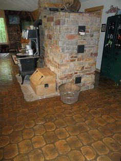 The Russian Masonry Furnace starts in the basement and works its way upward. It keeps the house warm with one firing a day!