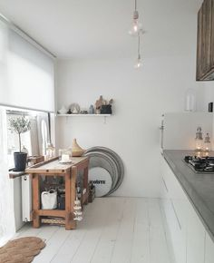 White washed floorboards in the kitchen of the latest House of Instagram! This post features Suus' simple scandi home that is full of natural, boho, scandi and vintage vibes with some super cool ethnic additions too!