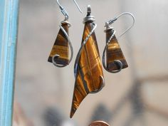 Tiger Eye Set of Silver Wrapped Pendant and Earrings by TheSilverMaster on Etsy https://www.etsy.com/listing/594452793/tiger-eye-set-of-silver-wrapped-pendant
