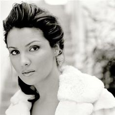 Anna Netrebko.  I love her.  Regina Spektor and her are my long-lost Russian sisters.  Its true.