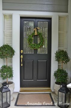I love these topiaries Amanda Carol at Home used on her front porch...from Home Depot!