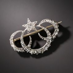 Antique Triple Crescent and Star Pin. We can only wonder why this may be the very first Victorian brooch we've encountered with three crescents (and a star) when the design is so symmetrically alluring. This nineteenth century jewel glistens with three-quarters-of-a-carat of bright-white rose-cut diamonds set in darkly oxidized silver over gold for an enchanting and celestial effect.