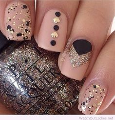 Glam nude nails with black and golden details