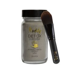 Muddy Body Detox Clay Mask  includes the healing powers of Dead Sea Clay, Activated Charcoal- a natural  magnet for toxins, and the hydrating and toning benefits of Witch Hazel and  Raw Cacao. This mask is powerful enough to draw out impurities, but gentle  enough to restore moisture and awaken fatigued skin for an everlasting glow.