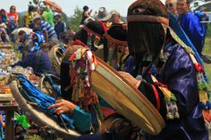"""Caption: A row of shamans chants in unison at the opening of a tailgan, a public sacrifice and festival performed annually or seasonally at a sacred site to renew solidarity between a community and its local spirits. This tailgan, organized at Bukha-Noyon, a sacred site in Tunkinskii District, Buriatiia (Russia) as part of the symposium and festival """"Psychophysiology and Social Adaptation of (Neo)Shamans in the Past and Present,"""" attracted artists, shamans, scholars, and tourists from around…"""