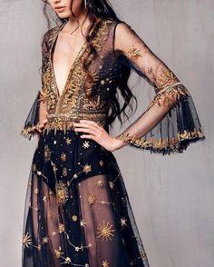 db3c8e23d28 Edgy boho chic celestial black and gold sheer maxi dress with deep V neck