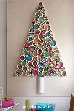Everything you need to make this tree is readily available at your local home center: plywood, PVC pipe, a saw, and epoxy. This wood is four by six feet, but you can adjust the size. #christmas #holidayideas #christmasideas #wintertodo #marthastewart Creative Christmas Trees, Christmas Tree With Gifts, Christmas Gifts For Mom, Christmas Tree Themes, Christmas Crafts, Holiday Decor, Modern Christmas, Christmas Morning, Christmas Candy
