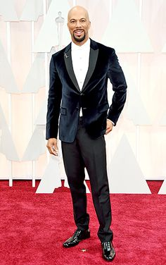 """One of the night's winners—for his song with John Legend, """"Glory""""—looked sharp in a velvet blazer (with a floral pin on one lapel) and black pants, with patent shoes and Fred Leighton jewels."""