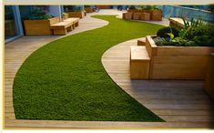 synthetic lawn and curved timber deck looks lovely and well manicured. synthetic lawn an Jardin Vertical Artificial, Artificial Turf, Artificial Grass Ideas, Synthetic Lawn, Timber Deck, Curved Decking, Small Garden Design, Terrace Garden, Gravel Garden