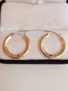 14K Fine Gold Hoop Earring with Unique Outer Edge Design Light Weight For Comfort signed 14K JCM = 585. TrendsCouture