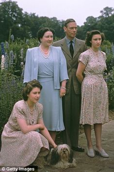 King George VI with Princess Elizabeth, Queen Elizabeth (crouching) and Princess Margaret, at the Royal Lodge at Windsor Castle in 1946.
