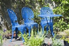 Blue iron patio furniture to go with herbs and teracotta pots