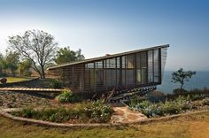 Over Water Bungalow in Pune, India by Design Workshop