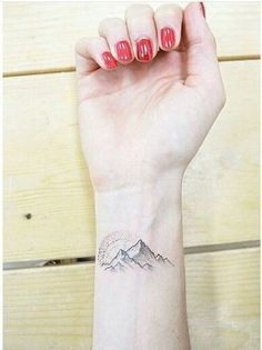 Mountain tattoos represent hurdles in life that must be overcome. Usually, mount. - Mountain tattoos represent hurdles in life that must be overcome. Usually, mountain tattoos are par - Tiny Wrist Tattoos, Wrist Tattoos For Women, Little Tattoos, Leg Tattoos, Tattoos For Guys, Detailliertes Tattoo, Chic Tattoo, Tattoo Motive, Small Tattoo Designs