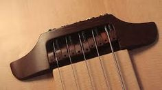 ผลการค้นหารูปภาพสำหรับ carved guitar bridge acoustic