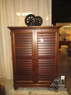 "Hooker shutter door entertainment cabinet in a dark finish. There is open space inside for a TV. Nice piece for a bedroom! Could even be repurposed for other uses with shelves added inside. 46""W x 25""D x 62""H."