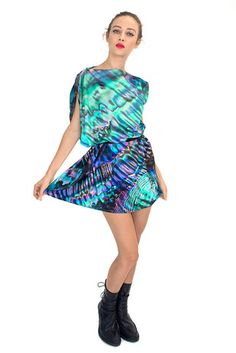 A dress that looks like the inside of an abalone shell.