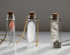 Put random things in a little jar and hook it to a necklace. Way cute!