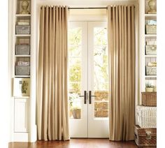 hang higher and wider than doors but treat as windows