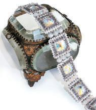 The Midwinter Bracelet is a classic design, sparkling Rivoli stones nestle in square pillows of Peyote stitch. The sqares are linked with Swarovski Briolette beads for added gleam.