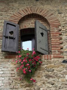 Love the hearts in the shutters and the flowers!