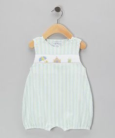 This timelessly treasurable piece is a great choice for little cutie-pies. Seersucker fabric and embroidered smocking make this bubble romper sing with vintage sweetness. Snaps inside the legs make life simple during dressing and changing.