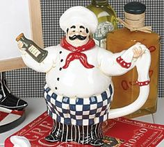 Fat French Chef Leeabaldi Teapot For Bistro Kitchen Decor  Sitting on your stovetop, this seasoned performer keeps your tea close at hand. A Fun fat French Chef is the figural design of this clever teapot..