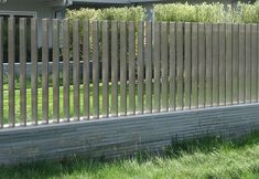 Square posts in low stone wall Yard Fence Ideas | Backyard Fence Types