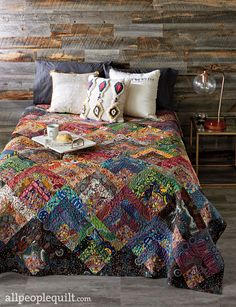 Colorful Cabins, an exclusive design from QuiltWorks. Fabrics are from the Aboriginal collection by M&S Textiles