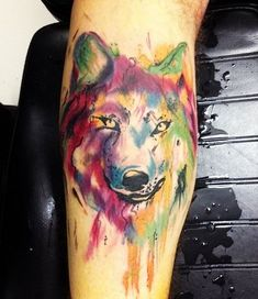 Amazing wolf watercolor tattoo on arm for woman