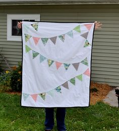 Here's my most recent baby quilt, made for some of our friends expecting their first little one in September. I was inspired by Cheryl at A Pretty Cool Life, who made a pennant quilt last yea…
