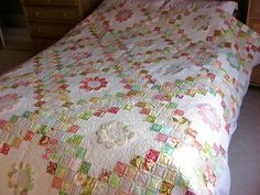 irish chain quilt and applique flowers.
