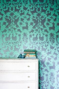 A DIY stenciled accent wall in mint and gray using the Otomi Allover Stencil. http://www.cuttingedgestencils.com/otomi-tribal-wall-pattern-stencil.html