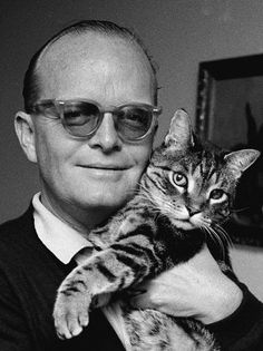 Truman Capote and a feline friend.