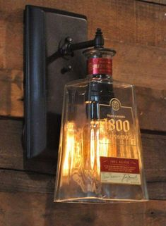 Bar/Man cave ideas: Recycled bottle lamp wall sconce 1800 Tequila by MoonshineLamp. Garrafa Diy, Diy Bottle Lamp, Bottle Wall, Bottle Bottle, Recycling, Tequila Bottles, Tequila Tequila, Game Room, Wall Sconces