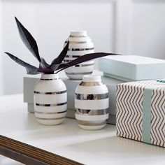 The wonderful miniature Omaggio vases with silver stripes blend elegantly with…