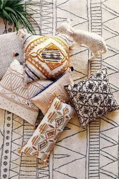 Tying the patterns of your pillows and rug together is a great way to add visual interest to a room!