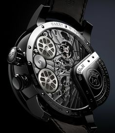 """Harry Winston Opus 14 Watch - on aBlogtoWatch.com """"Today, as we are in Baden-Baden, Germany, with Harry Winston, we have some terrific news for the fans of independent watchmaking: the Harry Winston Opus 14 watch has, at last, been revealed. Pursuing a '50s America vibe and featuring some automaton mechanisms inspired by the iconic record changer machines of the era, the Harry Winston Opus 14 appears to be more of a new beginning for the series than just another chapter..."""""""