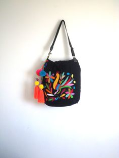 Items similar to La Bohemia Otomi Black and multi-color embroidery purse multicolored pom pom tassel (padded inside for iPad) Leather strap on Etsy Embroidery Purse, Bucket Bag, Ipad, Shoulder Bag, Stitch, Purses, Etsy, Trending Outfits, Unique Jewelry