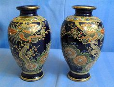 """B7103 £SOLD (Feb 2013).  Stunning pair of dark blue oriental vases approx 6"""" high and decorated with raised enamel and gilding."""