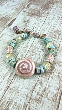 Beach Boho Jewelry Turquoise and Hill Tribe Silver Nautilus Shell Bracelet Like us on Facebook!