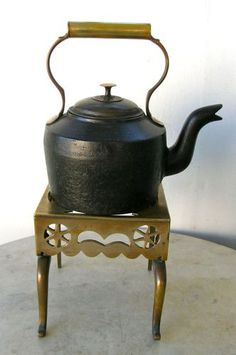 brass trivet & iron kettle