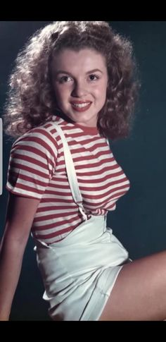 If she's not blonde it seems to be before she HIT Hollywood.  She was still Norma Jean Baker.