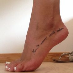 Most popular tags for this image include: quote, ynwa, tattoo, foot tattoo and youll never walk alone