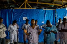 Health workers prayed before the start of their shift at the Bong County Ebola Treatment Unit in Liberia. Credit Daniel Berehulak for The New York TimesThe New York Times - Breaking News, World News & Multimedia