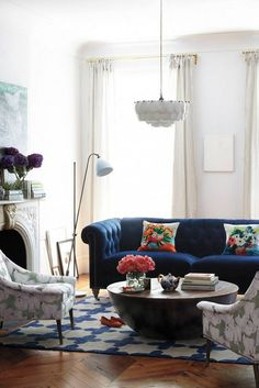 living room with blue couch