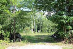 Residential lot, partly wooded with 1.9 +/- Acres. Partial basement in place where previous owner began building a home. No Restrictions!