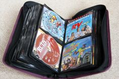 DVD storage in binders, with clipped movie cover to save its place :) from i heart organizing blog